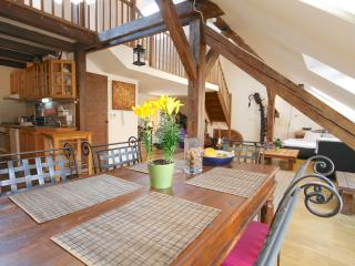 Original exposed oak beams. View from the dining area .