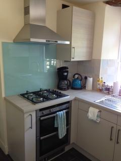 Brand new kitchen - double oven, gas hob, dishwasher, microwave, fridge, freezer, rear laundry room.