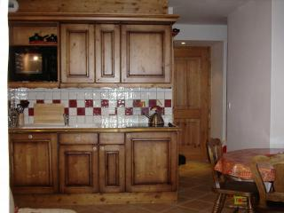 Kitchen has full size dishwasher, 4 ring hob, extractor, oven and fridge with freezer compartment