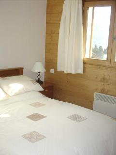 Double bedroom with views over village and valley