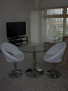 Dining Table and Chairs (two more chairs available)