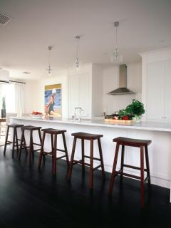 Designer Kitchen with European Applicances with French Doors Leading to Entertaining Deck