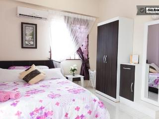 Master bedroom attached with own bathroom with hot shower, aircond, celing fan, etc.