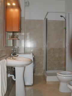 Shower room with toilet, bidet. sink & washing machine