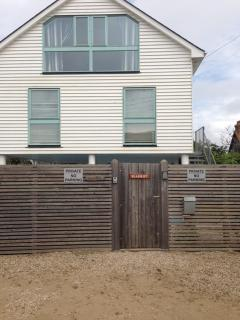 Secure gate with private parking at front of house