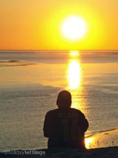 Sunset on Heysham Beach, Lakeland hills across the bay on the horizon