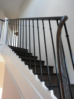 A restored oak staircase leads to...