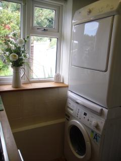 Washing machine with dryer in the kitchen