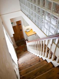 Up the wide and manageable stairs to the bedrooms , stairgates & doors at the top keep everyone
