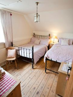 The last bedroom,small double and tall single period beds , with plenty of furniture and space too!