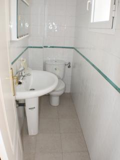 This toilet is housed in upper ground level by principal door, lounge/dining and kitchen areas
