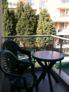 Our balcony with small table and chairs and clothes drying line.