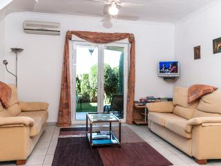 Lounge with flat screen TV, patio doors to private garden, enjoy afternoon sun & watch the sunse