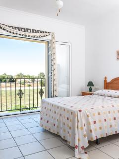 Fully furnished double bedroom with private views from Juliet balcony