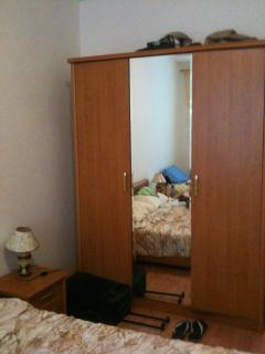 The bedroom has a large triple wardrobe with full length mirror.