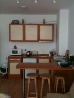 The kitchen has a breakfast bar and stools. Also the usual electrical items (see next picture).