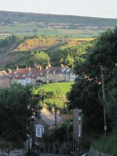 Robin Hoods Bay Bank with Pine Cottage and the moor in the distance
