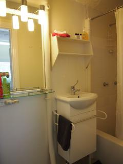Bathroom with shower, toilet, and vanity