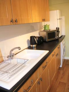 Fully equipped kitchen provided for your convenience