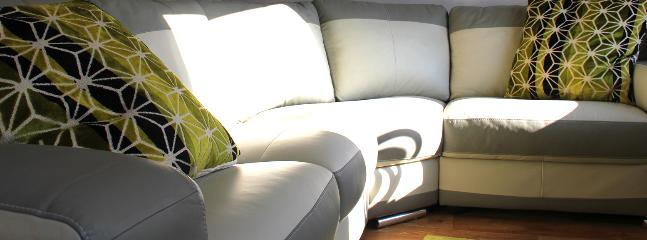 Comfy corner sofa with gas living flame fire, ideal for cosy winter nights