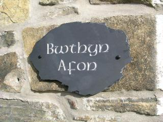 Bwthyn Afon's nameplate made locally using only the best Welsh slate!