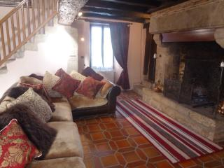 Relax in the luxurious lounge with cushioned corner suite, 9 ft fireplace and mezzanine above