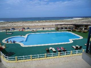 View from Vila Cabral 2, showing pools and Elcibar bar/restaurant for great snacks, drinks, meals.