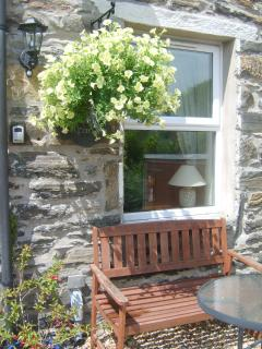 The front of the cottage enjoys a sunny aspect, sit and relax and enjoy the wine!