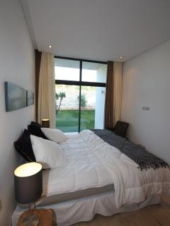 2 similar bedrooms , en-suite bathrooms and toilet ,with private terrace east on private garden