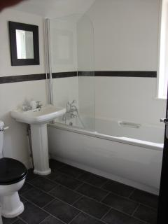 Modern bathroom, bath with shower attachment
