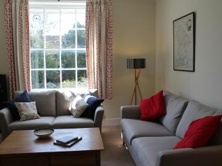 The sitting area is lit by a large Georgian sash window