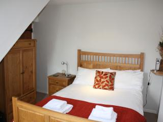 Main bedroom benefits from en-suite facilities, solid oak furniture, wardrobe and bedside table