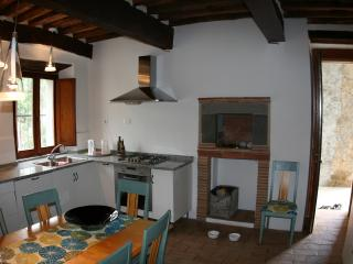 Fully equiped kitchen with direct access to the terrace.