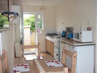 The Kitchen, with back door leading to private, enclosed garden