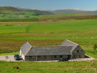 Bluefolds Steading  in the landscape with Dronach cottage at right. View to Cairngorm mountains