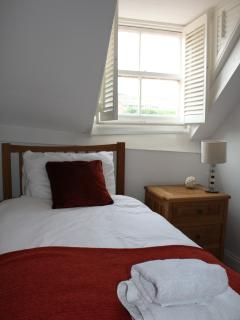 Single bedroom with views across the harbour.