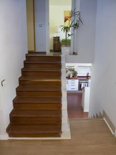 Stairs. Down the kitchen. Up the rooms