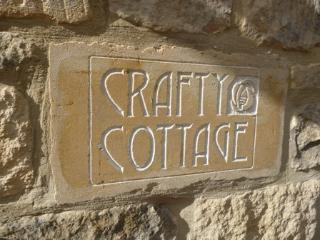 hand carved name plate at cottage by local Cotswold Stone Carver