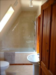 The Bathroom has a bath & shower with access from master bedroom and hall. Bathroom recently fit