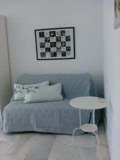 Master bedroom en-suite showing sofa bed and double wardrobe