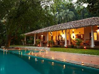 The main villa at dusk- sleeps 9 guests