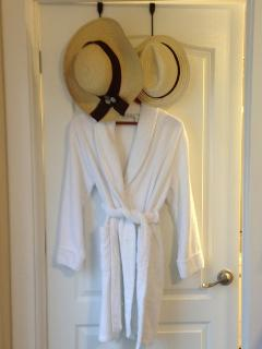 It's not the Hilton, but we still provide a comfy robe & something the Hilton doesn't - beach hats!
