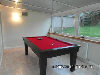 Slate bed pool table in conservatory for some recreation