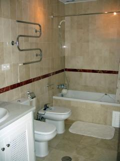 The ensuite bathroom to the main bedroom has a bath/shower/jacuzzi, WC, bidet, heated towel rail