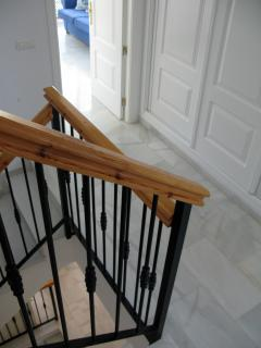 The marble floors are continued throughout and the stairwell links all four floors
