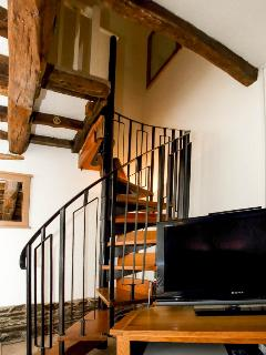 Attractive spiral staircase provides access to upstairs bedrooms and bathroom.