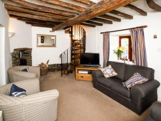 Quirky main lounge with flat screen TV, orginal oak beams and wood burning stove.