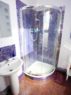 The ensuite has a large & powerful corner shower...