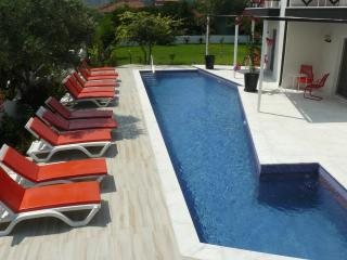 Pool and sun beds in vibrant red