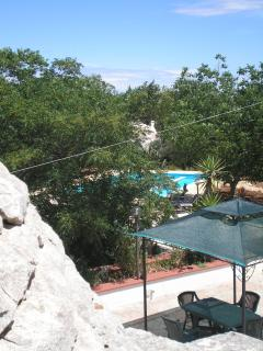 Bird's eye view of terraces and pool from trullo